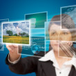 Woman hand reaching images streaming from the deep. - Stock Photo