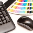 Color swatches and computer keyboard, mouse — Stock Photo