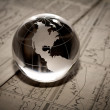 Globe with financial papers — Stock Photo