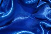 Blue satin textile background — Stock Photo