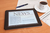 News on digital tablet. — Stock Photo