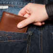 Stealing wallet from back pocket — Stock Photo