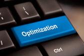 Blå knappen optimering ord om laptop tangentbord. — Stockfoto