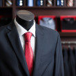 Men's business suit on a dummy - Stock Photo