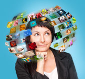 A technology woman has images around his head. — 图库照片