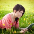 Stock Photo: Woman using tablet outdoor