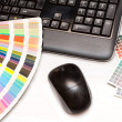 Color swatches and computer keyboard, mouse — Stock Photo #30105351