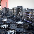 Stockfoto: Abandoned car rims field