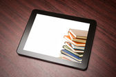 Tablet with book — Stock Photo