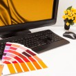 Stock Photo: Designer at work. Color samples.