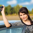 Stock Photo: Young girl with car key in hand