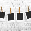 Stock Photo: Photos hanging on clothesline on brick wall background