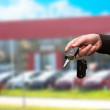 Hand with a car key. — Stock Photo