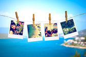 Photos of holiday hanging on clothesline with sea — Stock Photo