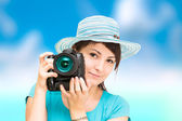 Woman photographer with camera — Stok fotoğraf