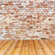 Stock Photo: Old brick wall on wood floor