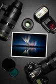 Camera lens and image on black background — Stock Photo