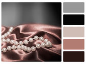 Pearls on a silk colour palette swatch — Stock Photo