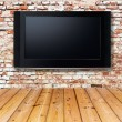 Television set on an old wall — Stock Photo