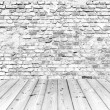 Old brick wall on wood floor — Stok fotoğraf