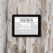 Tablet computer with business news — Stock Photo