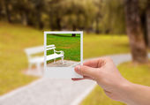 Holding Instant photo. — Stock Photo