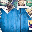 Frame with old paper and photos on wooden background. — Stock Photo #38732945