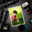 Stock Photo: Camera lens and image on black background