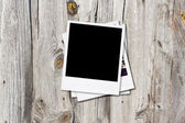 Blank photo frames on old wooden background. — Stock Photo