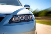 Rear side view of a sport car in blurred motion — Stock Photo