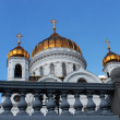 Gold domes of the temple against the dark blue sky — Stock Photo