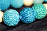 Blue crocheted beads — Stock Photo