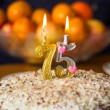 Candles on the birthday cake — Stock Photo