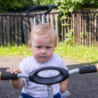Stock Photo: On the tricycle
