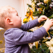 Boy decorates the Christmas tree — Stockfoto #46289833