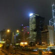 Street and building of Hong Kong city at night - Stock Photo