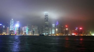 Skyscrapers in Hong Kong city at night from Victoria harbour view — Stock Video