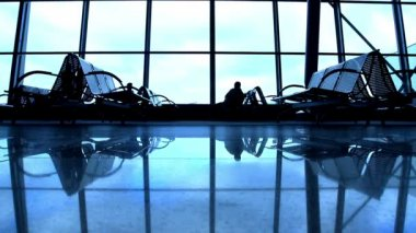 Silhouettes walking at airport space — Stock Video #12657313