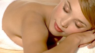 Young beautiful and relaxed lady taking spa treatment — Stock Video