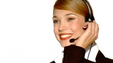 Beautiful young businesswoman is wearing headset — Stock Video