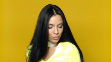Sexy girl with shopping bag on yellow background — Stock Video