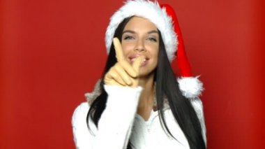 Portrait of beautiful sexy girl wearing santa claus hat — Stock Video