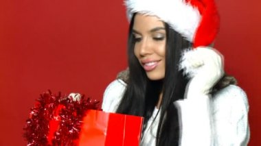 Sexy girl in santa claus hat with shopping bags — Stock Video