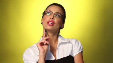 Portrait of beautiful business woman on yellow background — Stock Video