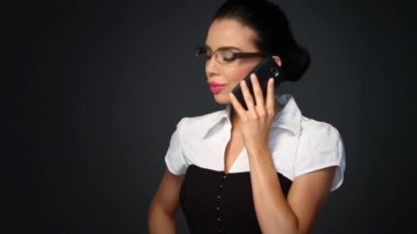 Portrait of beautiful business woman talking cell phone — Stock Video