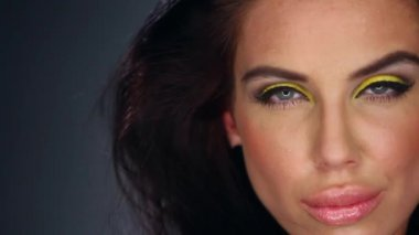 Sexy brunette in outstanding yellow makeup — Stock Video