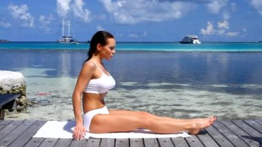 Beautiful woman resting near water at Maldives — Stock Video #12778850