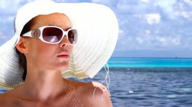 Beautiful woman resting near water at Maldives — Stock Video #12779048