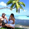Stock Video: Romantic couple resting at Maldives seaside