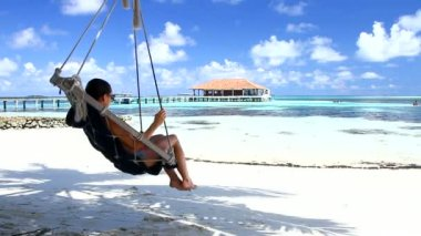 Beautiful and sexy woman resting at Maldives seaside — Stock Video #12781269